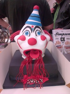 A novelty birthday cake with a clown's head