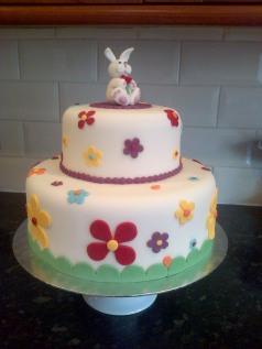 Easter theme birthday cake with rabbit and flowers