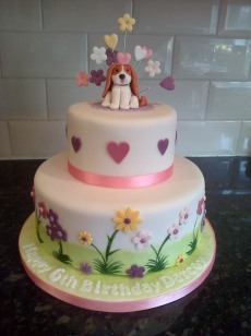 Dog theme 6th birthday cake with hearts and flowers