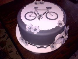 Grey and white bicycle theme birthday cake