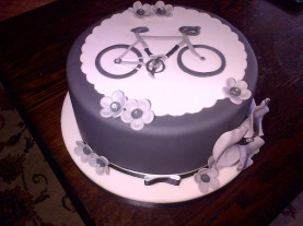 Grey and white bicycle theme birthday cake