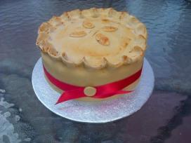 Pork pie shaped chocolate birthday cake