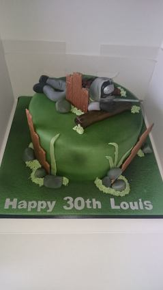 30th birthday cake with man playing paintball