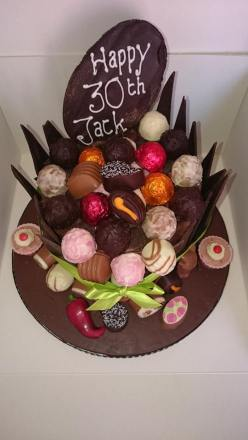 Chocolate 30th birthday cake with added chocolates