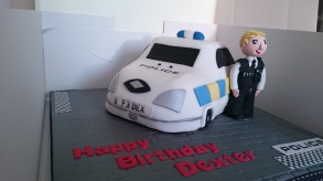 Police car birthday cake with a policeman