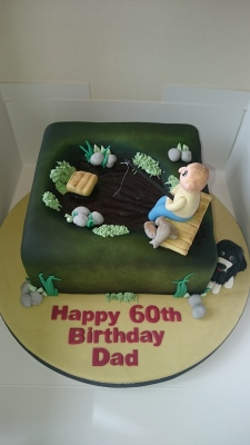 60th birthday cake with man fishing and a dog