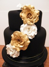 Black wedding cake with handmade gold and silver sugar roses
