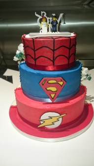 Semi-naked half and half wedding cake with handmade sugar flowers and superhero design