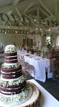 Rustic naked chocolate wedding cake with fresh gypsophila