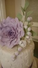 Lace design wedding cake with handmade sugar flowers