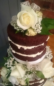 Naked chocolate wedding cake with fresh flowers