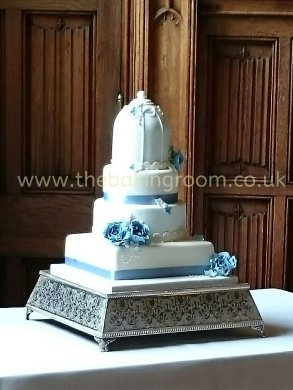 birdcage wedding cake with blue flowers