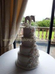 elegant wedding cake with waterfall of flowers