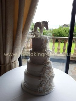elegant wedding cake with waterfall of flowers