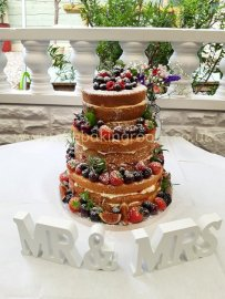 naked wedding cake with fresh fruit