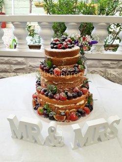 naked wedding cake with fresh fruit
