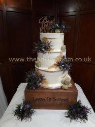 semi naked wedding cake with macarons
