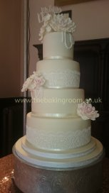 wedding cake with lace and flowers
